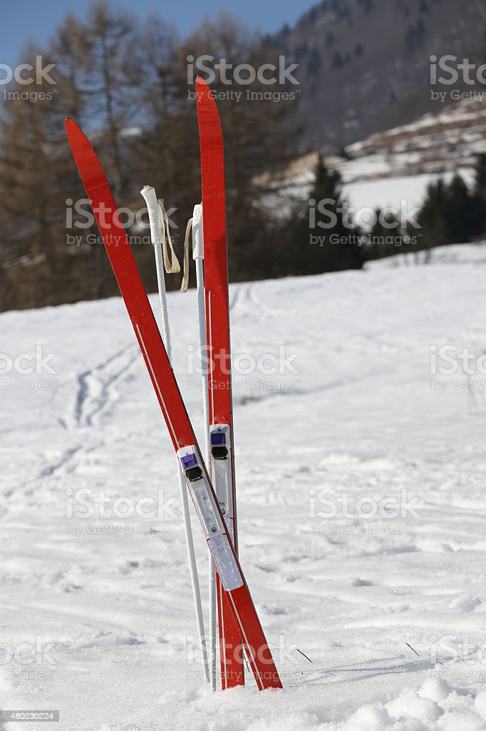 red cross country skiing in winter stock photo