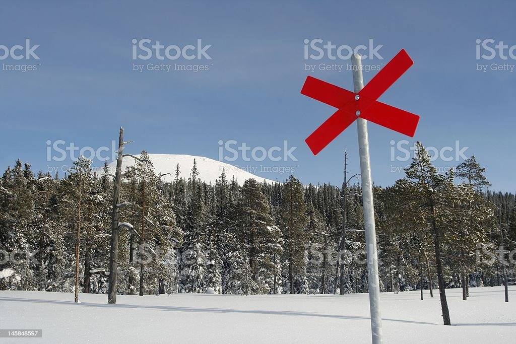 Red cross on ski trail stock photo