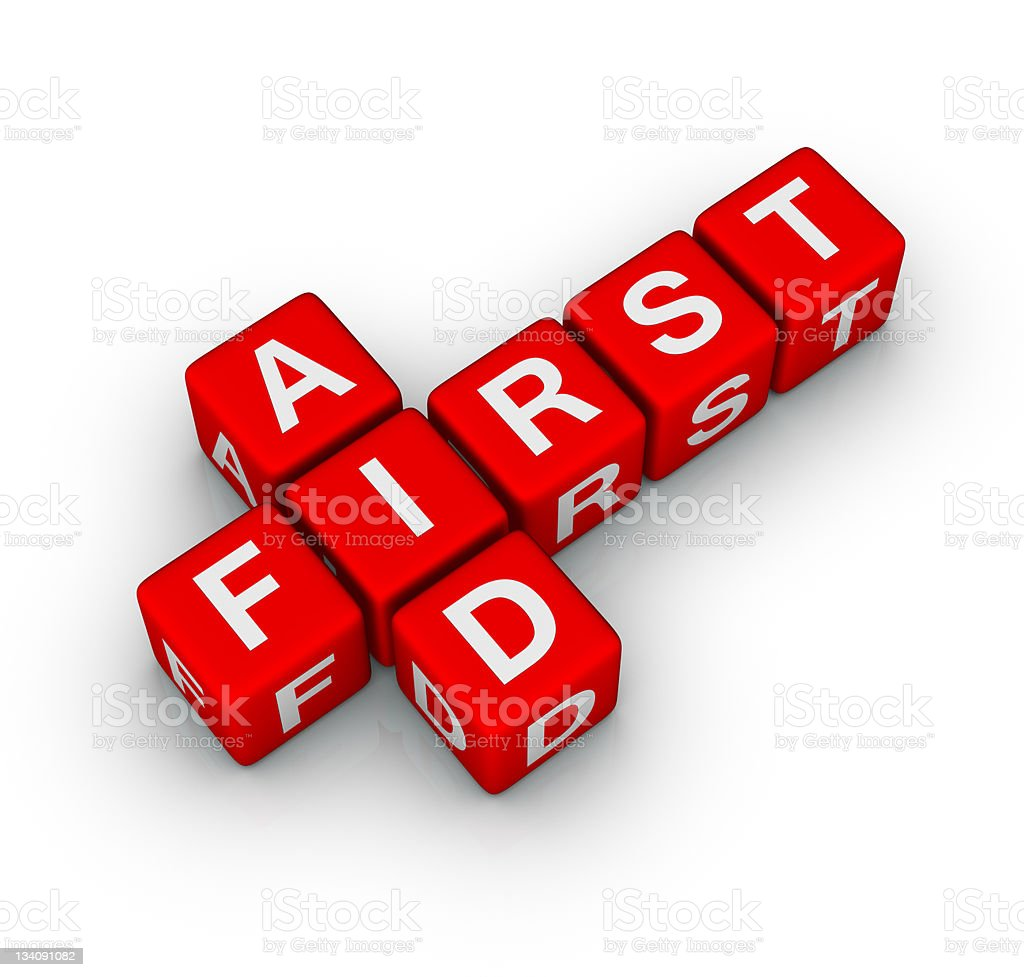 A red crossword forming the words First Aid stock photo