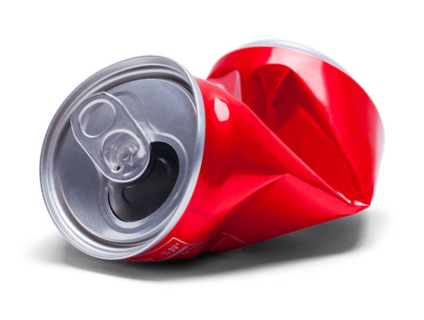 Red Crushed Soda Can Empty Smashed Soda Pop Can Isolated on White Background. crushed stock pictures, royalty-free photos & images