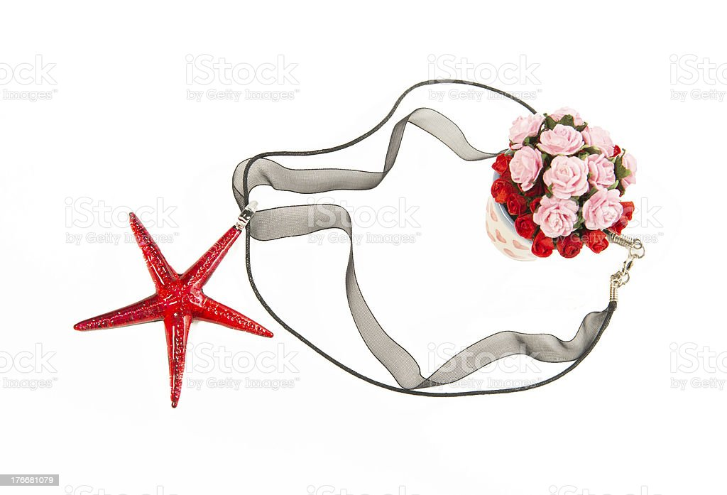 Red crystal star fish necklace with bush of roses royalty-free stock photo