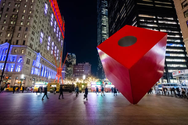Red Cube steel cuboid public sculpture in New York City stock photo