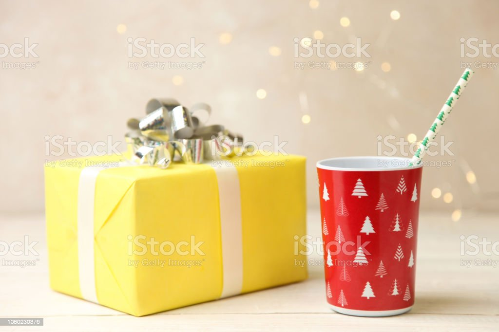 Red  cup and yellow gift stock photo