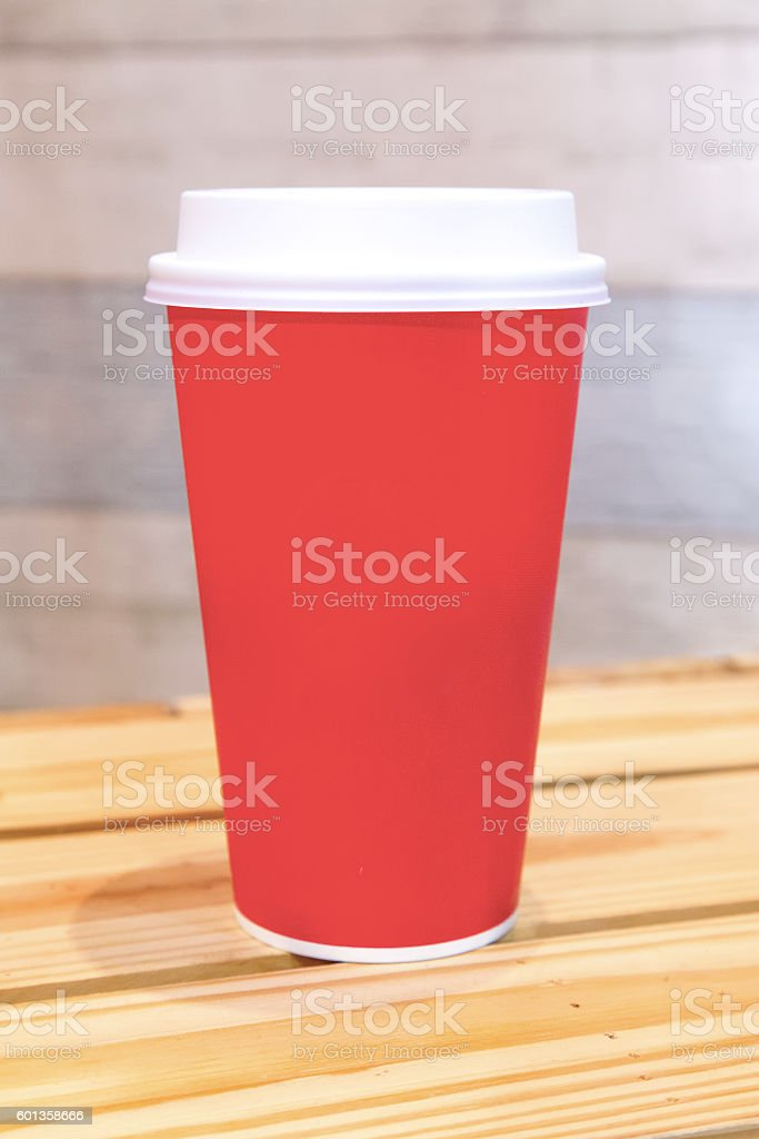 Red cup of coffee on wood table stock photo