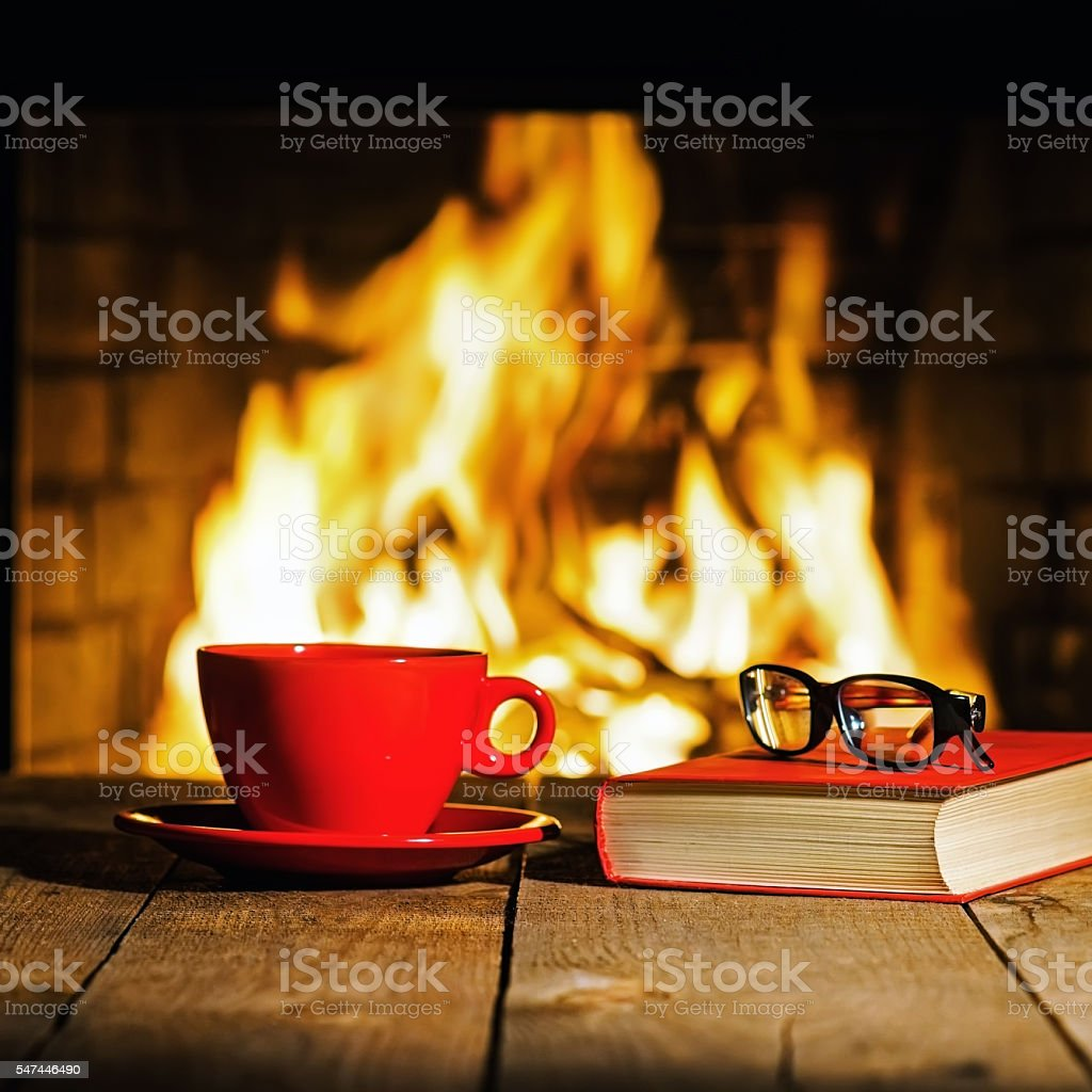 Red cup of coffee or tea, glasses and old book stock photo