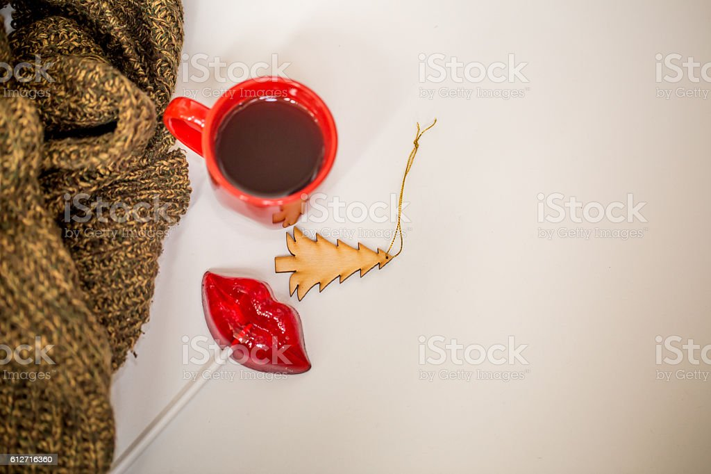 red cup of hot drink with christmas items royalty free stock photo