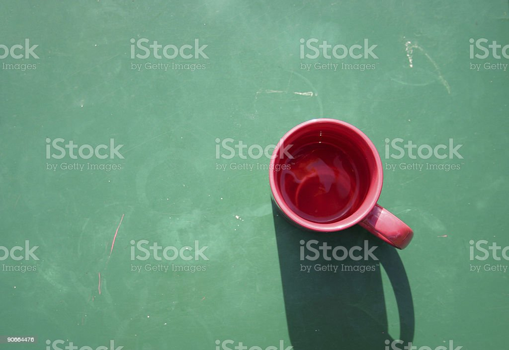 Red cup on green royalty-free stock photo