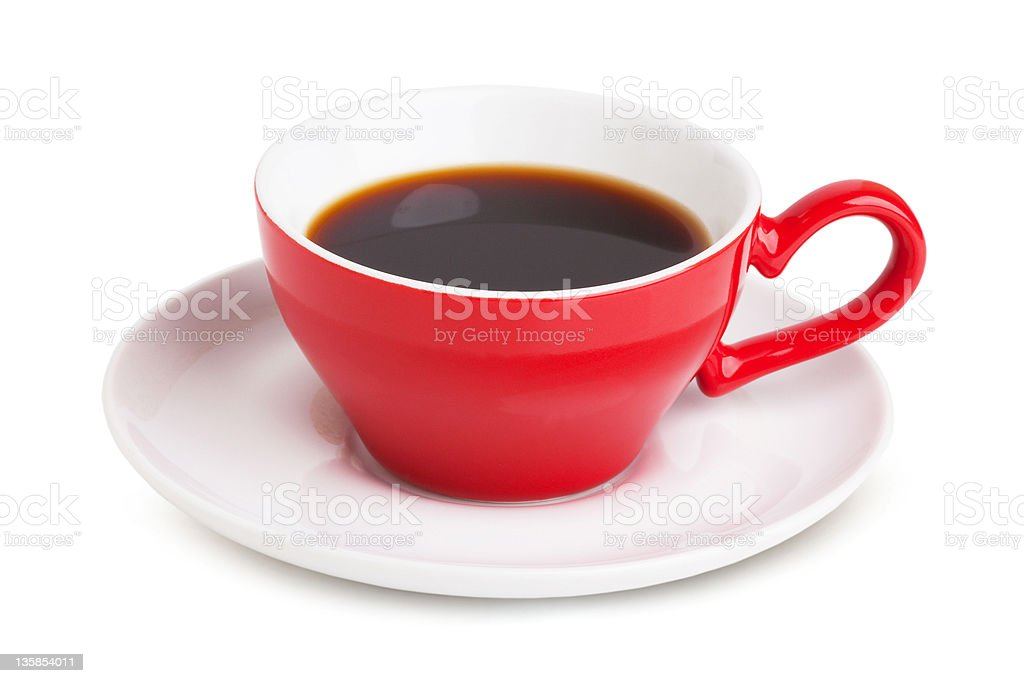 Red cup with instant coffee on a white saucer royalty-free stock photo