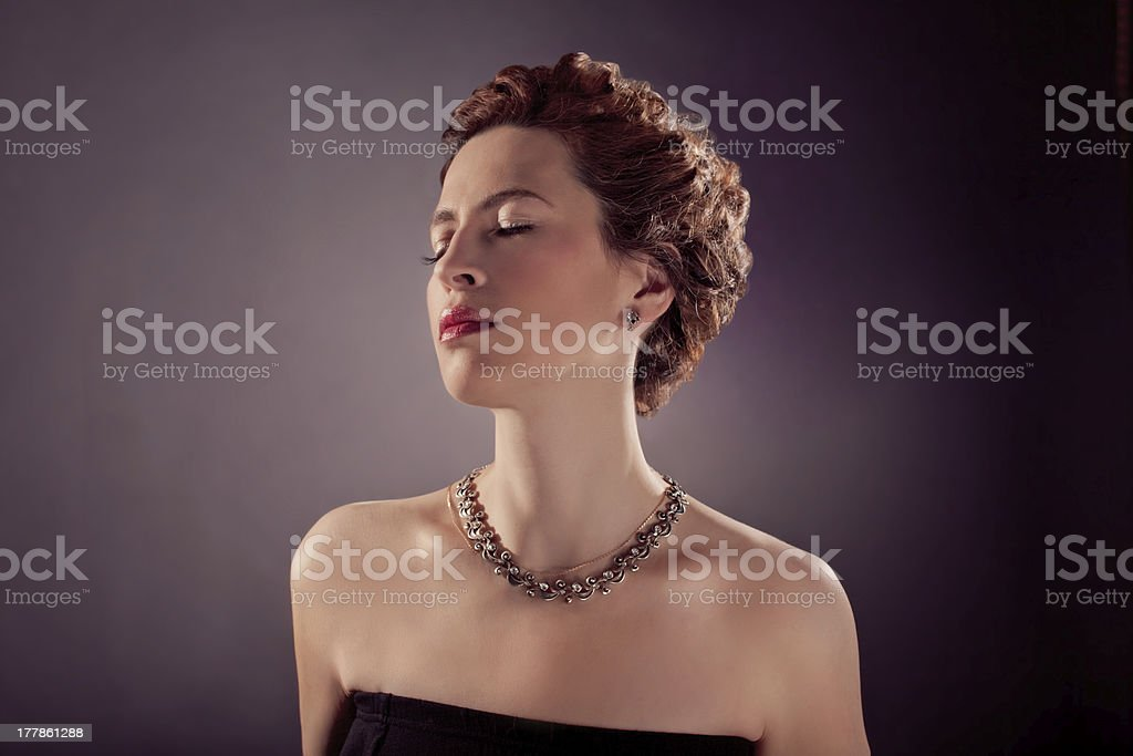 red curly hair  mature woman in black tight dress stock photo