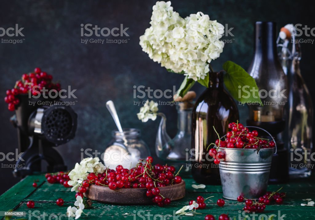 Red Currant Berries In Wooden Bowl Metal Bucket And In Black Hand