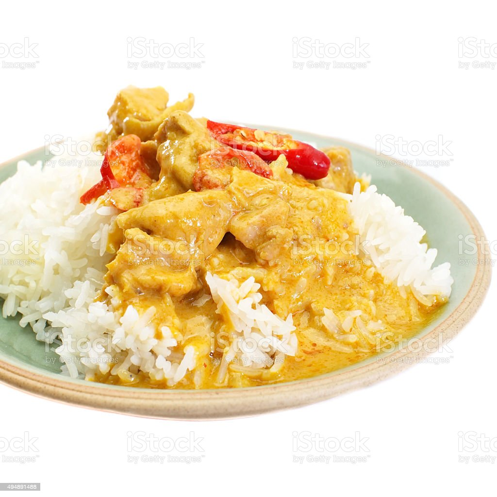 Red curry chicken and white rice on white background stock photo