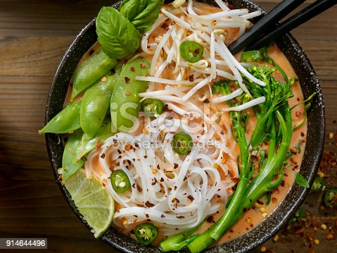 Thai Red Curry Noodle Soup with Broccoli, Bean Sprouts, Fresh Basil, Lime and Chili Flakes