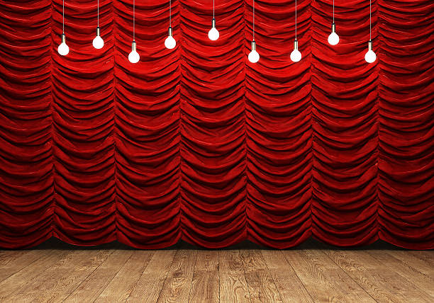 Red curtain and wooden floor with retro light bulbs stock photo
