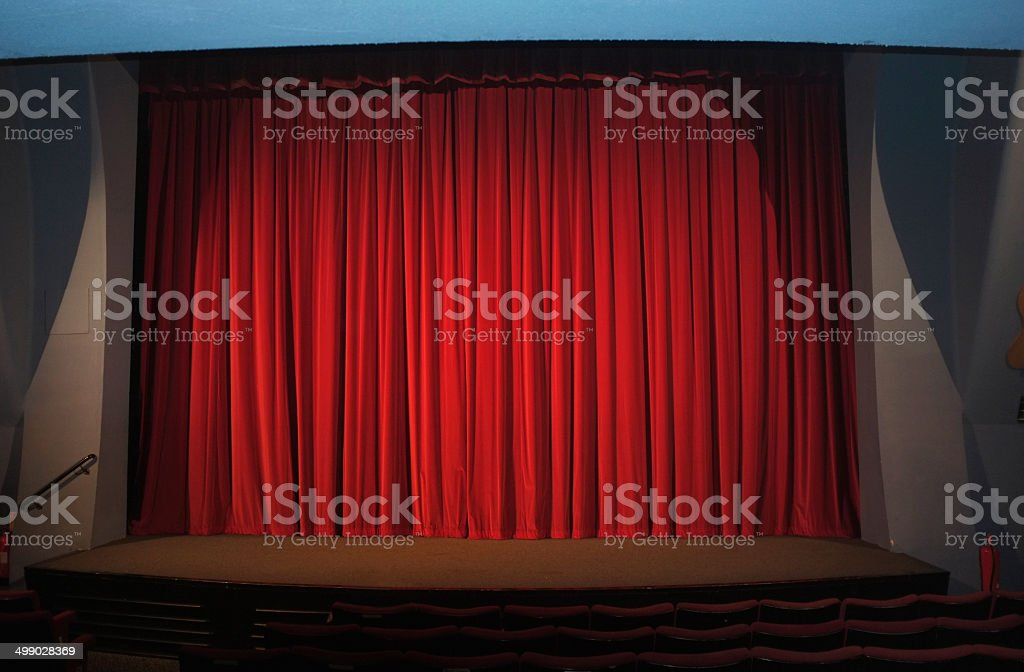 Red curtain in cinema stock photo
