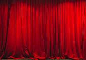 Red curtain in theater on stage.