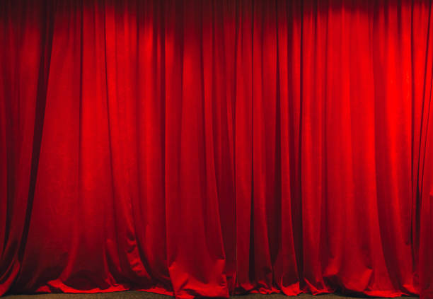 Red curtain in theater on stage. stock photo