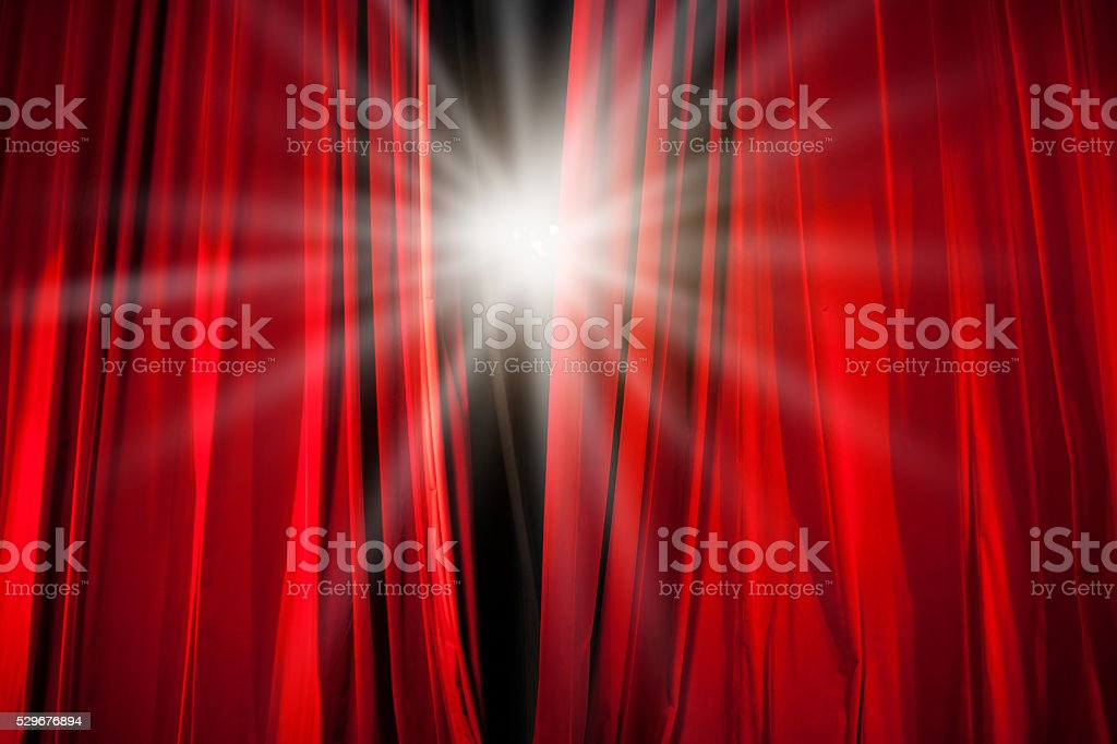 Red Curtain Opening With Stage Light Shining Through Royalty Free Stock  Photo