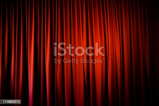 Theatre curtain background with vignette.