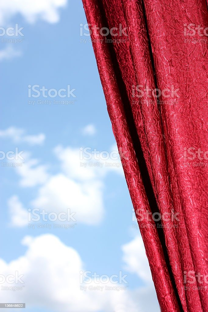 Red curtains and cloudy sky royalty-free stock photo