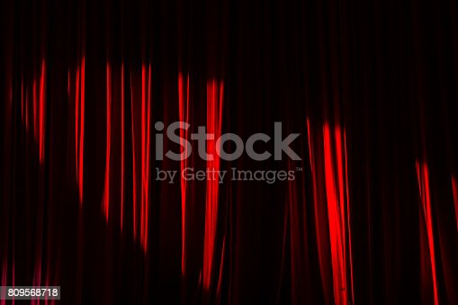 istock Red curtains and light. 809568718