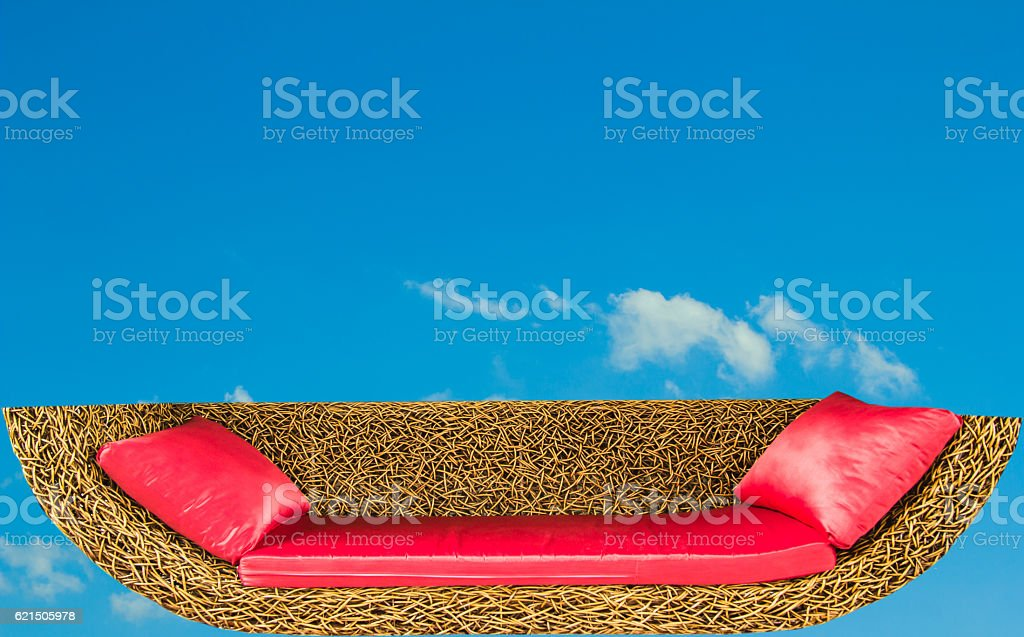 Red cushion on the sofa and blue sky photo libre de droits