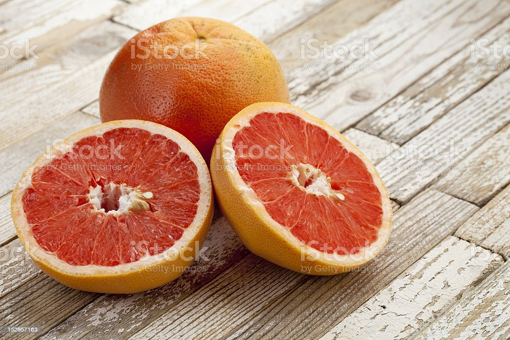red cut grapefruit stock photo
