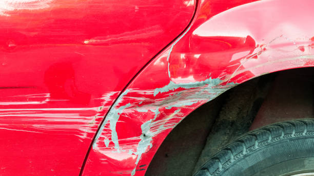 red damaged car in crash accident with scratched paint and dented metal body - dent stock pictures, royalty-free photos & images