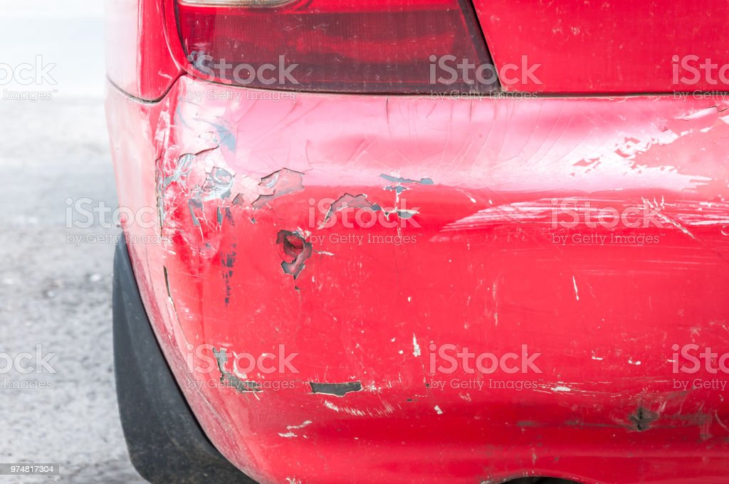 Red Damaged Car In Crash Accident With Scratched Paint And