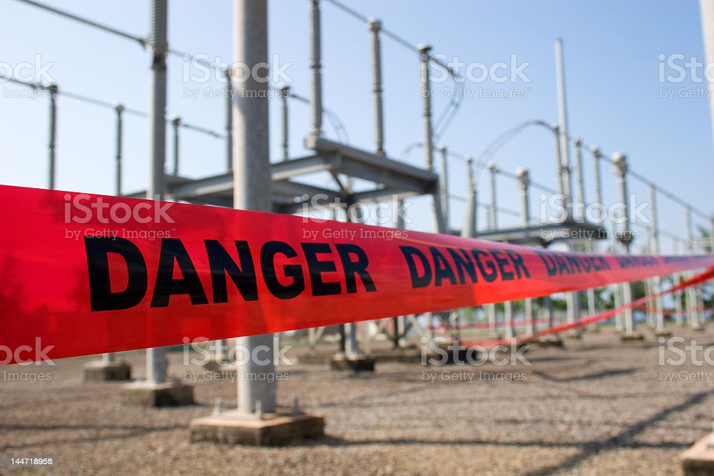 Red danger tape barricades high voltage area royalty-free stock photo