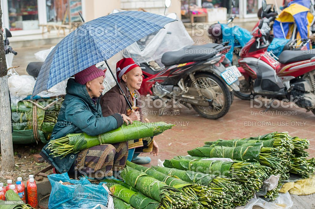 Red Dao women at a market in Sapa, Vietnam stock photo