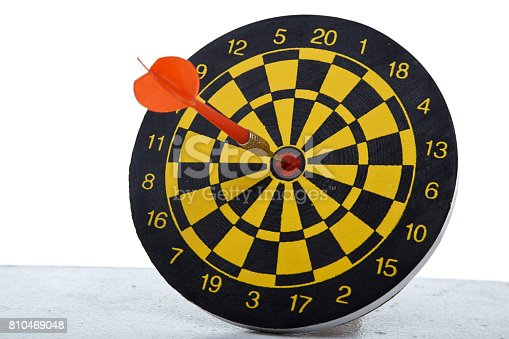 istock red dart In a dartboard on white 810469048