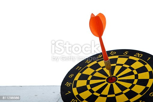 istock red dart In a dartboard on white 811298586