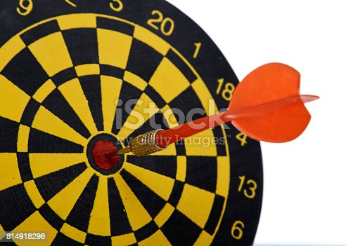 istock red dart In a dartboard on white 814918296