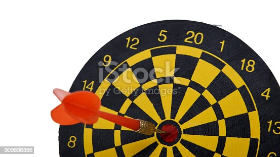 istock red dart In a dartboard on white 909836396