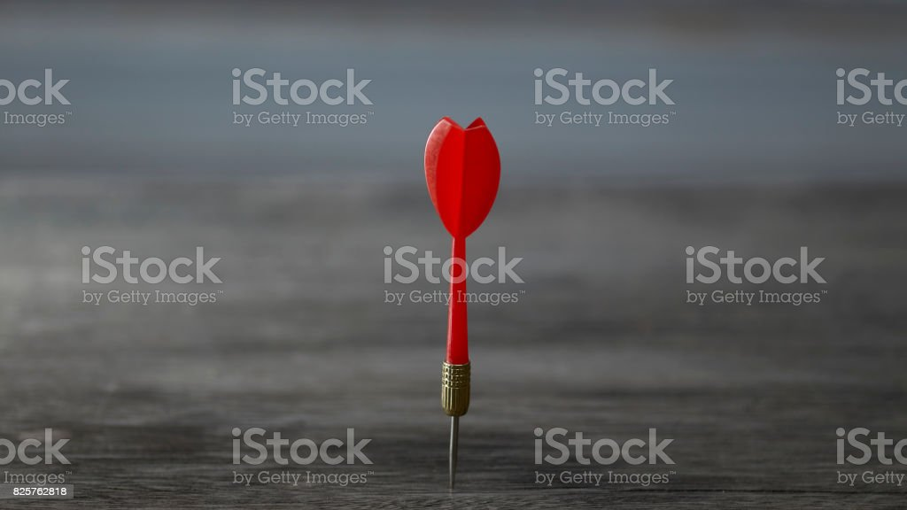 red dart on the brown wooden stock photo