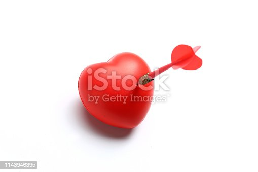 970844120 istock photo Red Dart Stuck in Heart Isolated on White Background. 1143946395
