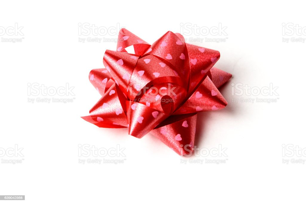 Red decoration gift ribbon star on white background isolate stock photo