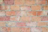 Beige decorative brick wall. Masonry, background, texture