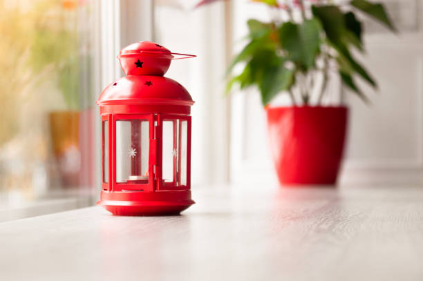 Red Decorative Lantern Near The Panoramic Window Stock Photo