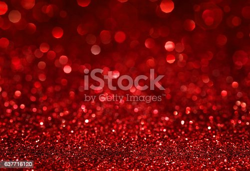 Red defocused glitter background with copy space