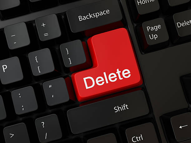 a red delete button on a black keyboard - delete key stock photos and pictures