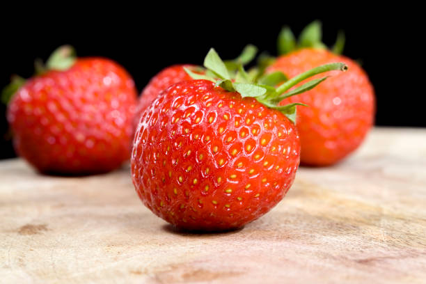 red delicious strawberries stock photo
