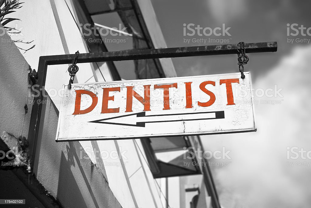 red dentist sign with arrow royalty-free stock photo