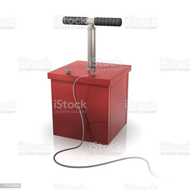 Old fashion detonator in red with plunger and wires.