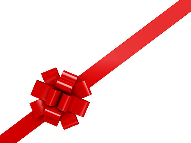 Red diagonal ribbon with a bow over a white background stock photo