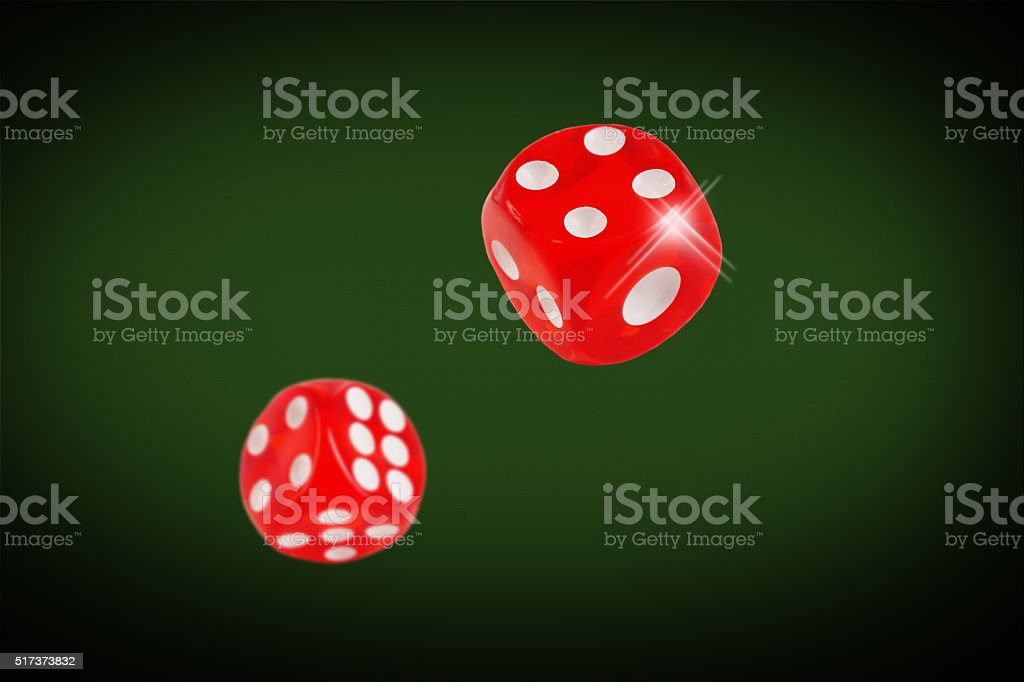 Red dice fall on the casino table. concept stock photo