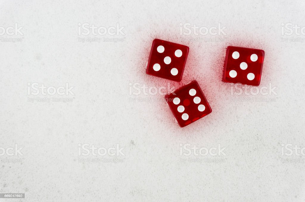 Red dice on a light background. stock photo