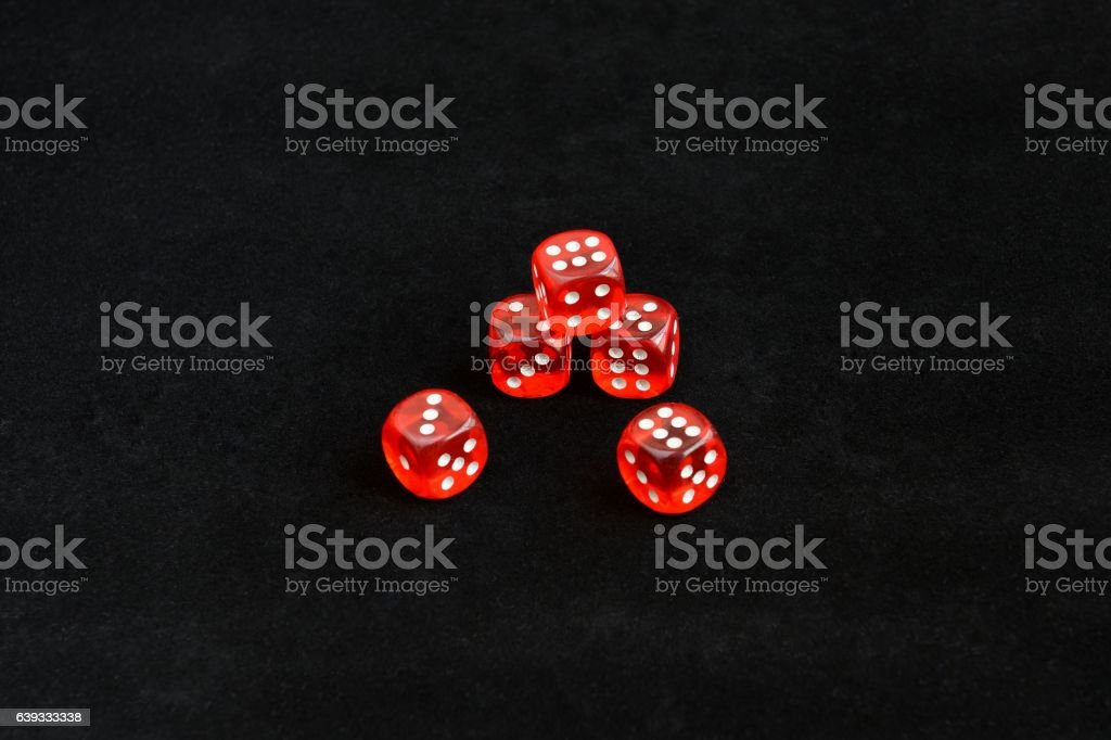 red dice on black background stock photo