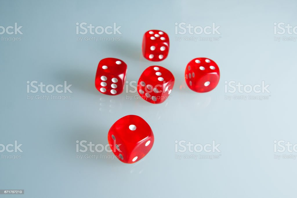Red dice on the glass. Five dice with the value from 'one' to 'five' stock photo
