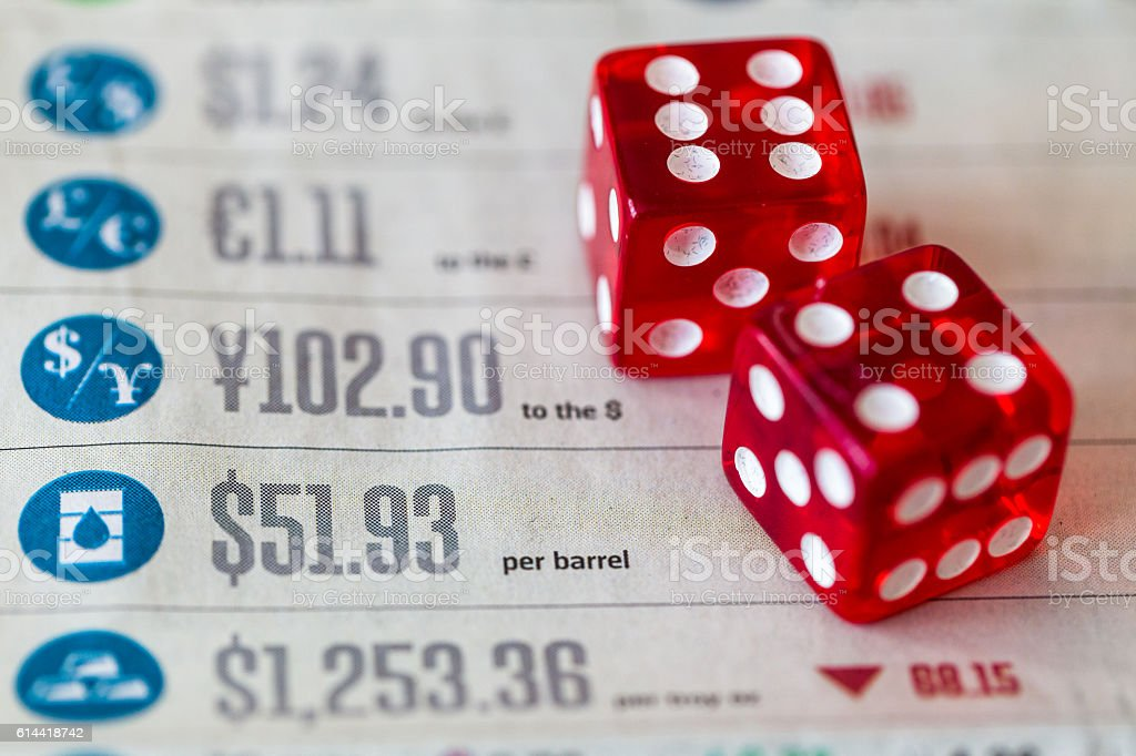 Red dice on top of global currency market figures stock photo
